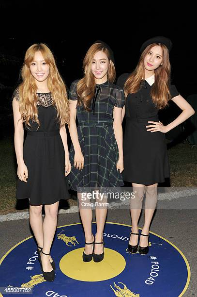Girls' Generation-TTS attend the Polo Ralph Lauren fashion show during Mercedes-Benz Fashion Week Spring 2015 at Cherry Hill in Central Park on...