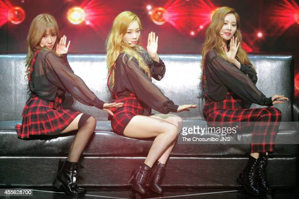 Girls' GenerationTTS perform onstage during their mini album Holler showcase at Woori Art Hall on September 16 2014 in Seoul South Korea