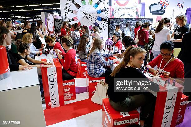 Girls get their nails polished during the Get Beauty fair a beauty and fashion fair inspired by the US 'Beautycon' event gathering of fashion...
