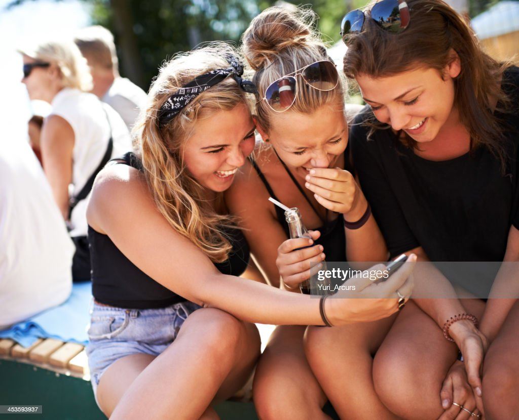 Girls getting in on the gossip : Stock Photo