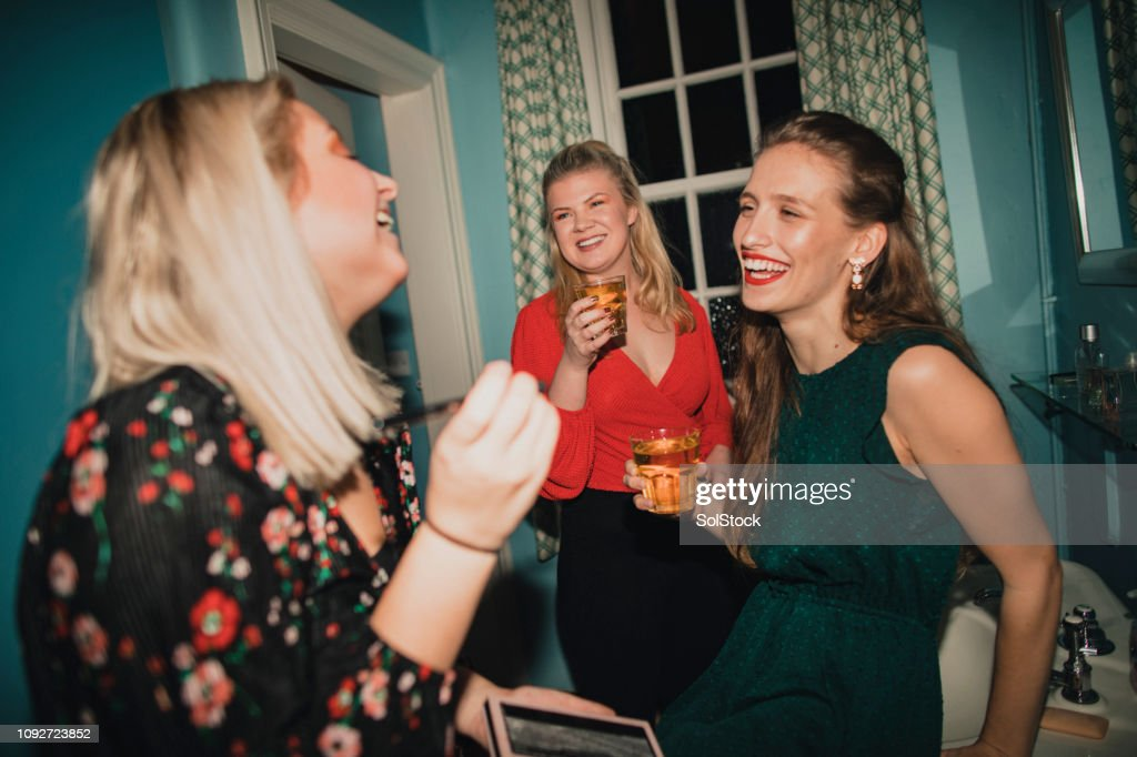 Girls Getting Ready in the Bathroom : Stock Photo