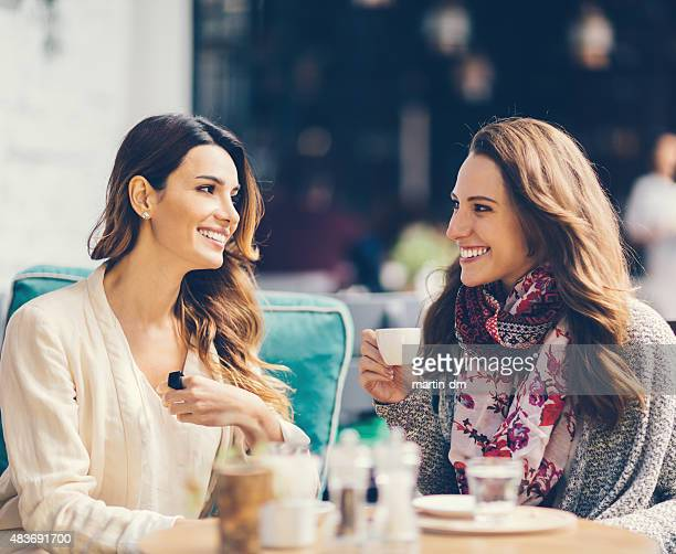 girls gossiping at outdoors cafe in istanbul - pavement cafe stock pictures, royalty-free photos & images
