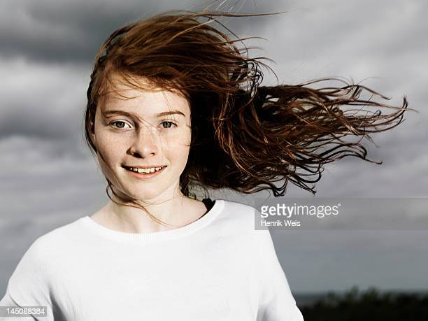 girls hair blowing in wind outdoors - wind stockfoto's en -beelden