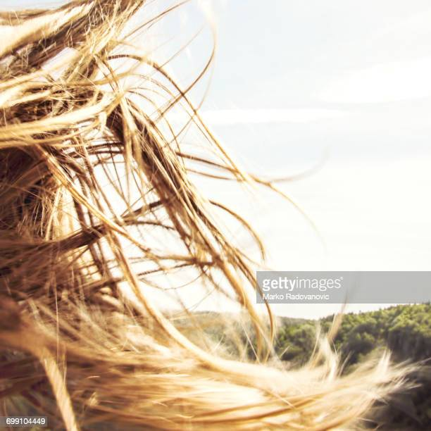A girls hair fluttering in the wind