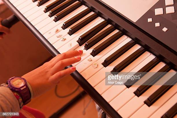 girl´s hand playing keyboard. - electric piano stock photos and pictures