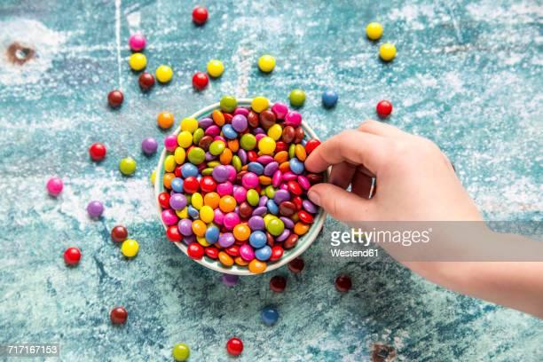 Girls hand taking chocolate button