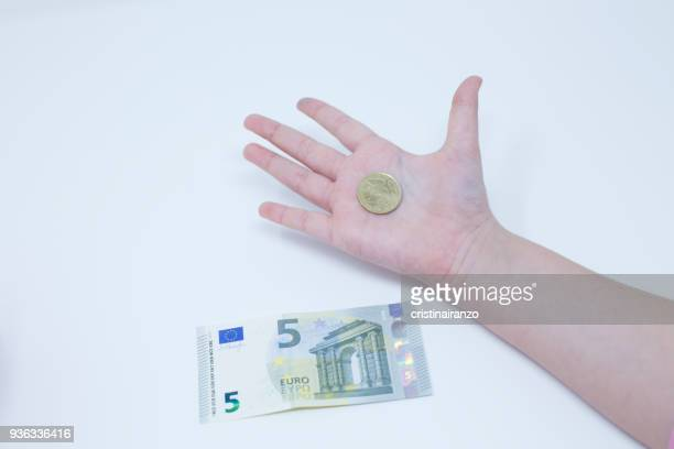 Girl's hand with a coin