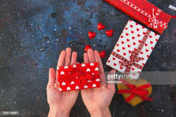 Girl's hands holding a wrapped gift