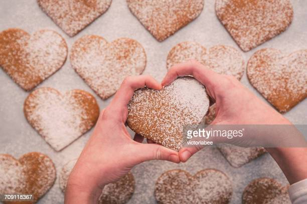 Girl's Hands holding heart shaped cookies