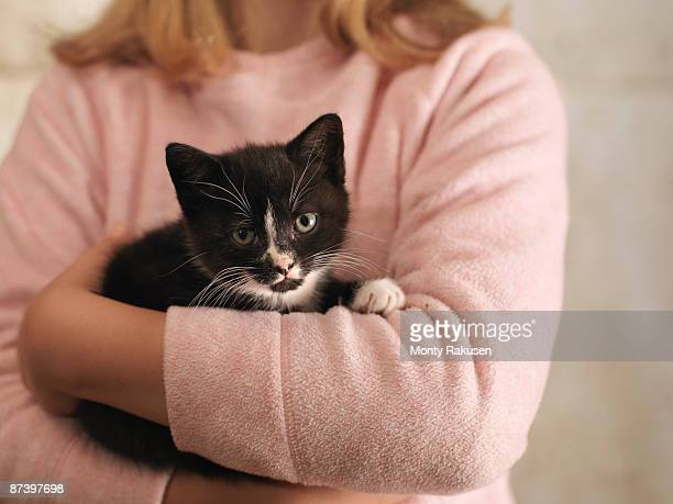 Girl's Hands Holding Kitten