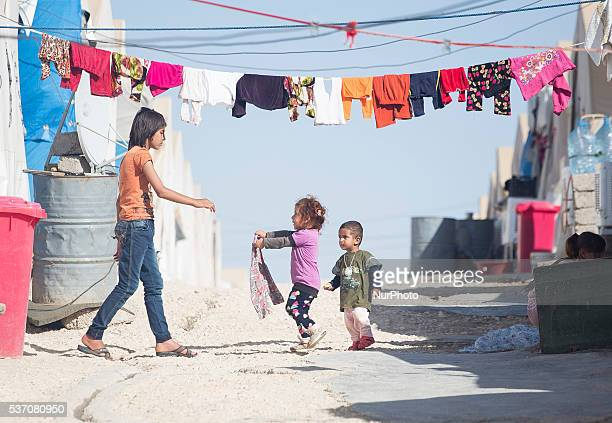 Girls hang laundry in camp close to Sharya village on 01 June 2016 in Kurdistan Iraq