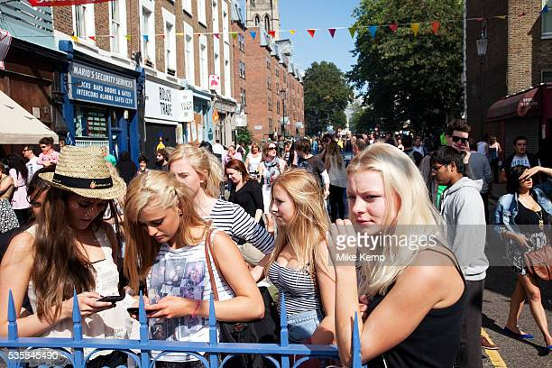 Girls hanging out waiting for friends at the Notting Hill Carnival in West London The Notting Hill Carnival is an annual event which since 1964 has...
