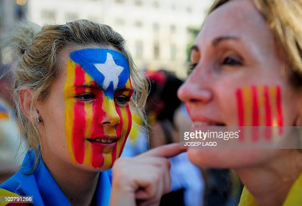 Girls has the Catalan colors painted on their face as hundreds of thousands of people marched on July 10 2010 in Barcelona in support of the Catalan...