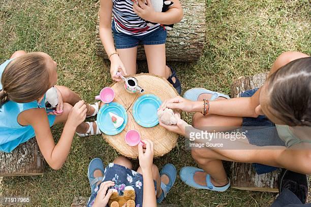 Girls having a tea party