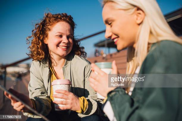 girls having coffee and talking - women's issues stock pictures, royalty-free photos & images