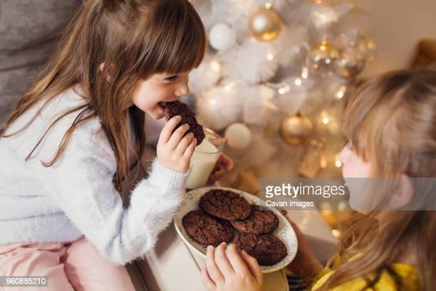 Girls having cookies at home