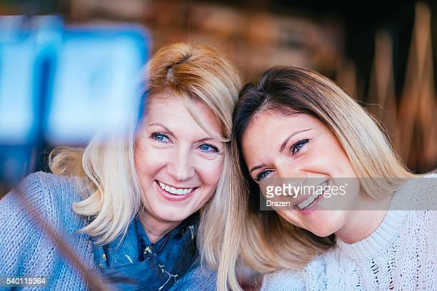 Girls having fun and taking selfie shot
