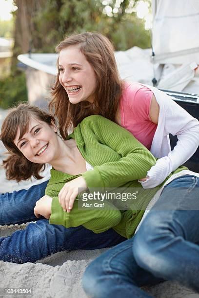 2 girls having fun at a beach