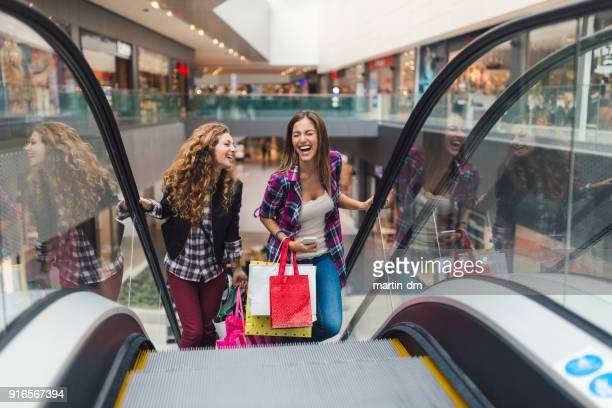 girls having fun in the shopping center - shopping mall stock pictures, royalty-free photos & images