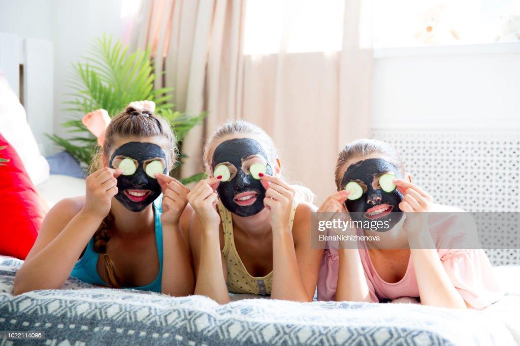 Girls having fun on slumber party together : Stock Photo