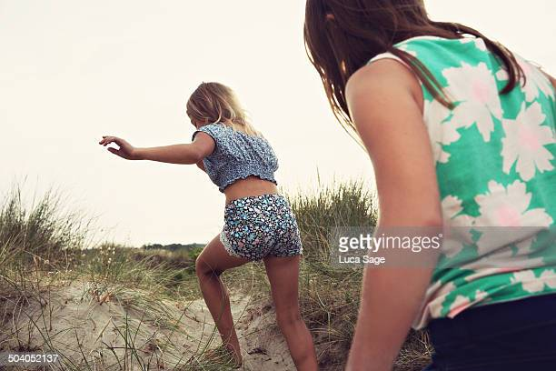 girls having fun on the beach - children only stock pictures, royalty-free photos & images