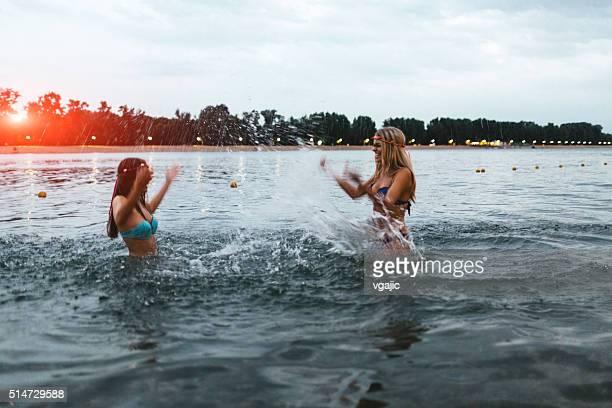 Girls Having Fun On The Beach.