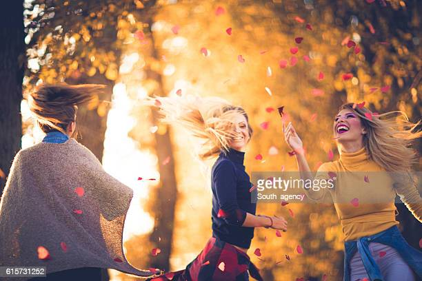 girls having fun with confetti - heart month stock photos and pictures