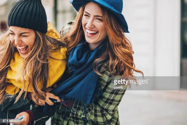girls having great time together - downtown comedy duo stock pictures, royalty-free photos & images
