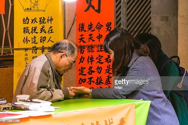 Girls having their palm read in Tainan, Taiwan