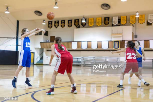 girls high school basketball game - defense player stock pictures, royalty-free photos & images