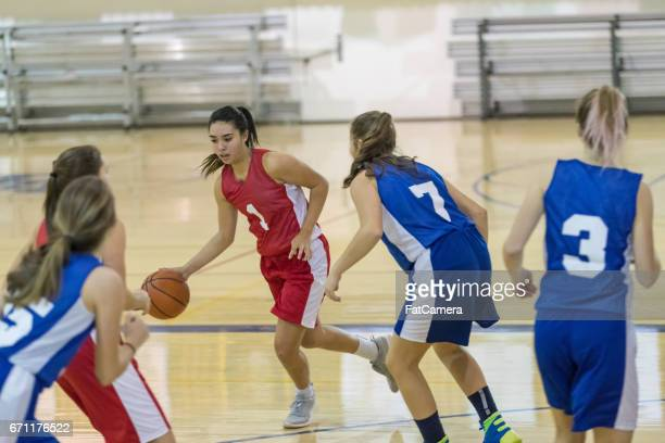 girls high school basketball game - charging sports stock pictures, royalty-free photos & images