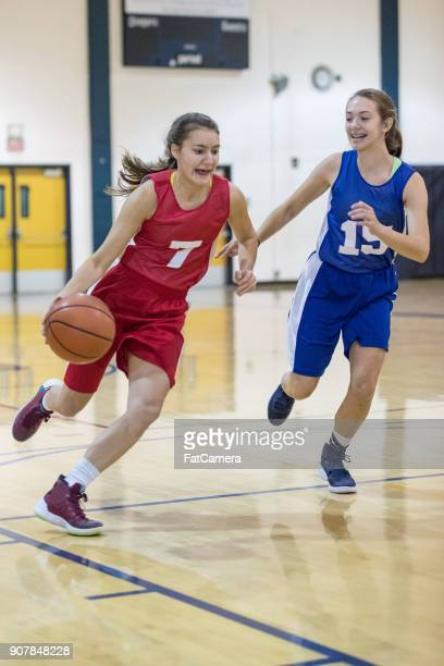 girls high school basketball game - dribbling sports stock pictures, royalty-free photos & images