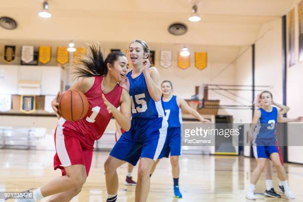 girls high school basketball game - passing sport imagens e fotografias de stock