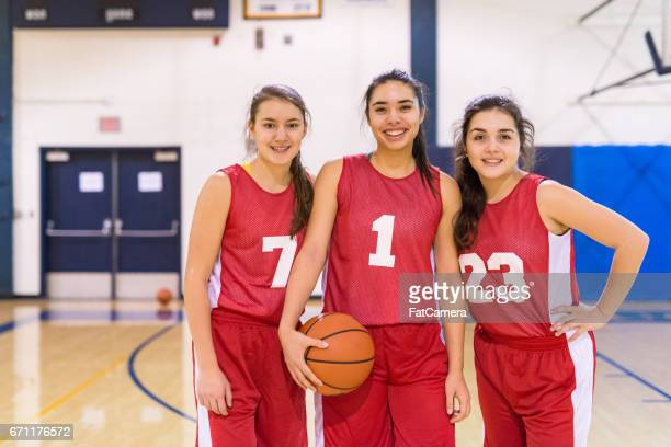 girls high school basketball team - charging sports stock pictures, royalty-free photos & images