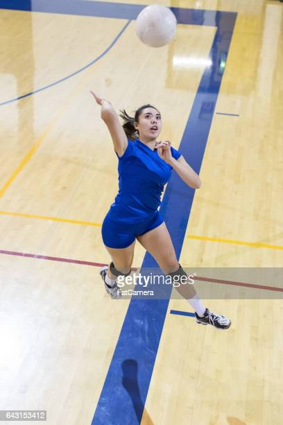 girls high school volleyball team - spiking stock photos and pictures