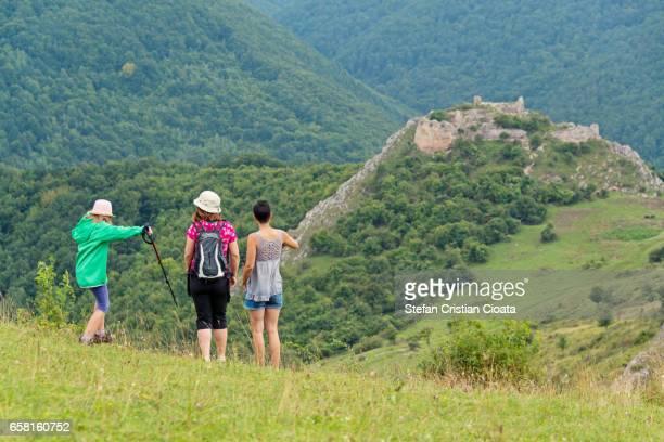 Girls hiking to Liteni fortress Transylvania