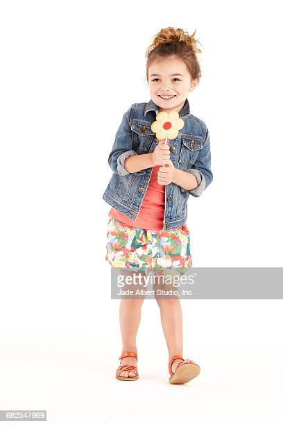 girls holding flower cookies