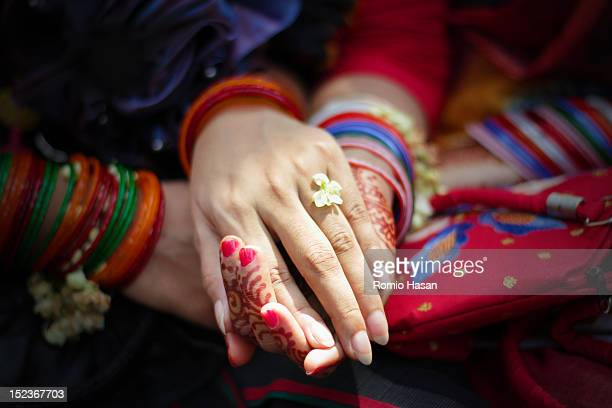 girls holding hands together - bangladesh new year stock photos and pictures