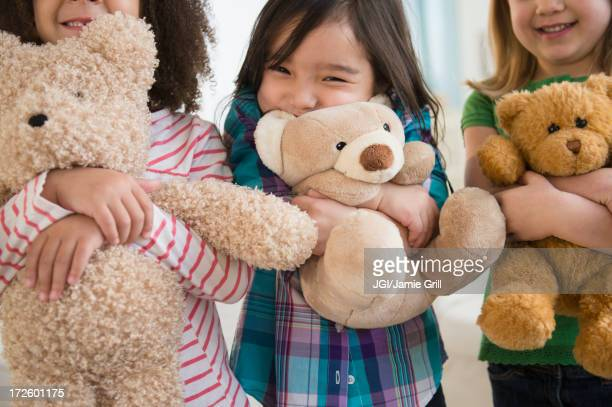 girls hugging teddy bears - teddy bear stock photos and pictures