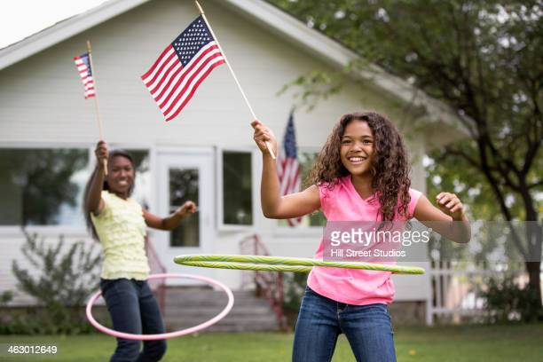 Girls hula hooping with American flags