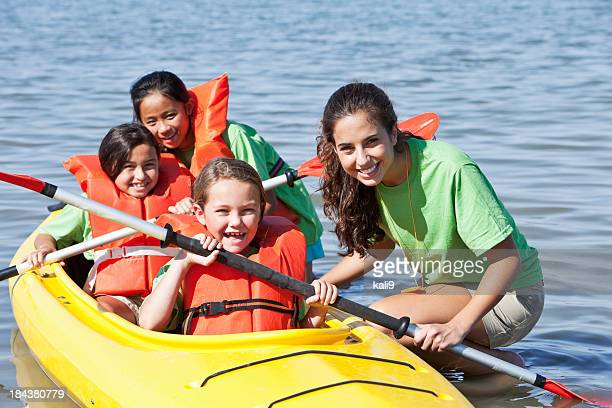Girls in a double kayak at summer camp