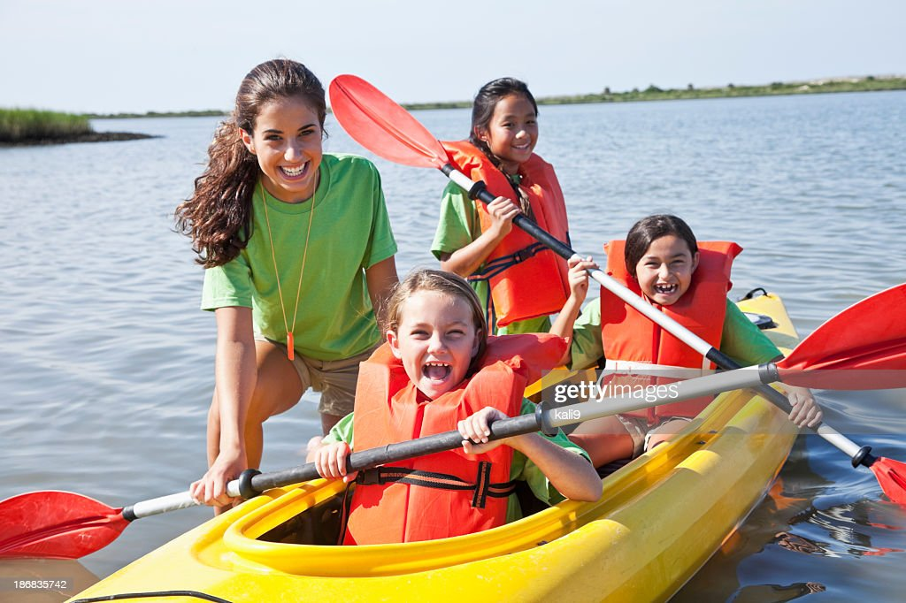 Girls in a double kayak : Stock Photo