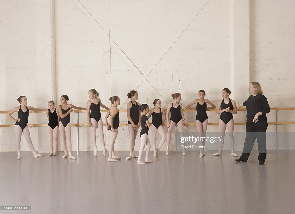 Girls (9-13) in ballet class with ballet instructor : Stock Photo