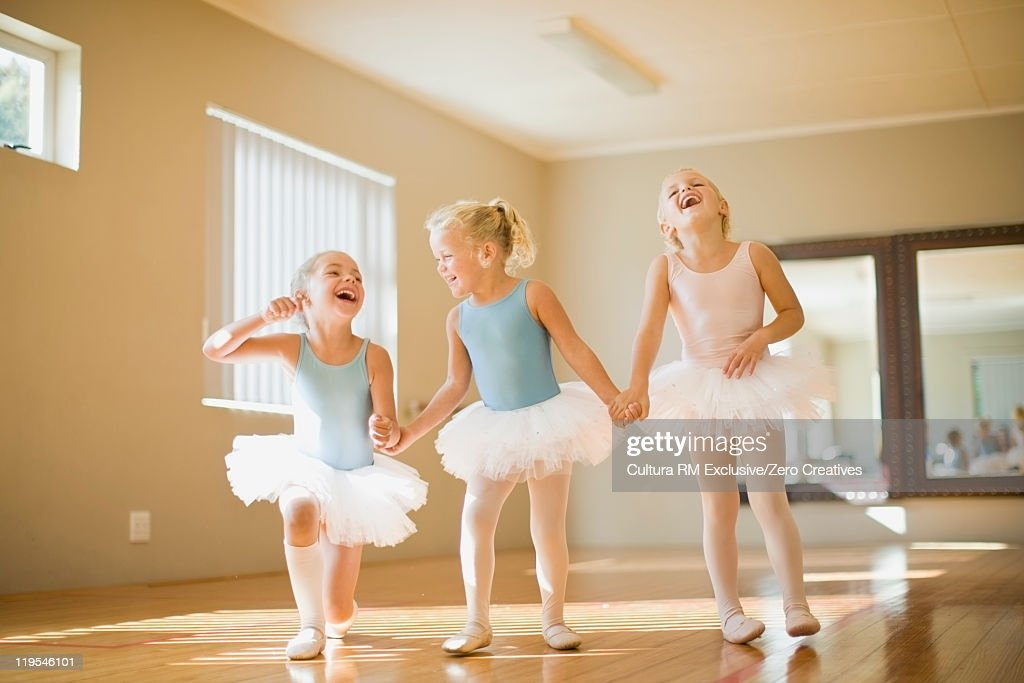 Girls in ballet costumes laughing : Stock Photo
