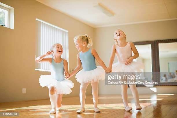 Girls in ballet costumes laughing