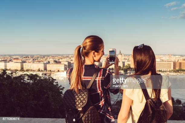 girls in budapest taking photos - budapest stock pictures, royalty-free photos & images