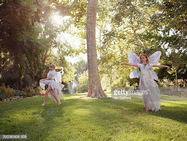 Girls (9-12) in butterfly costumes dancing