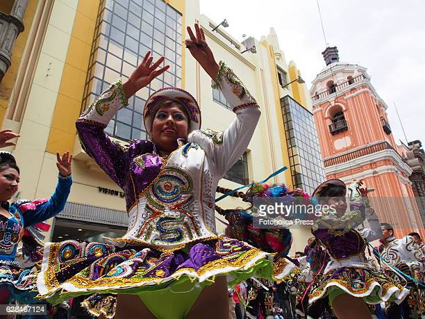 """Girls in folk costumes dancing in an Andean folkloric parade and """"morenada"""", a traditional dance, celebrating the day of Our Lady of the Rosary in La..."""