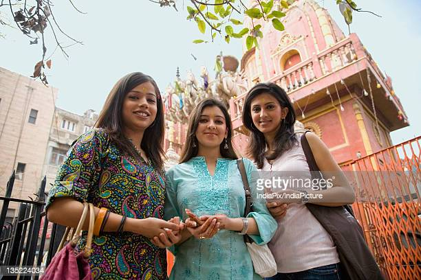 Girls in front of a temple