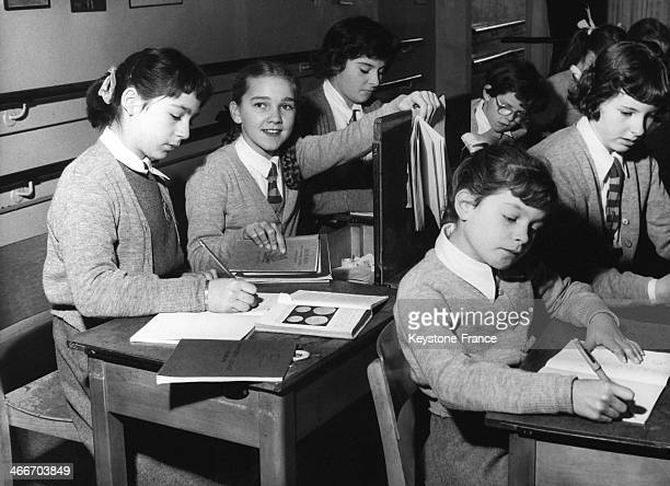 Girls in in classroom during biology lesson circa 1950 in United Kingdom